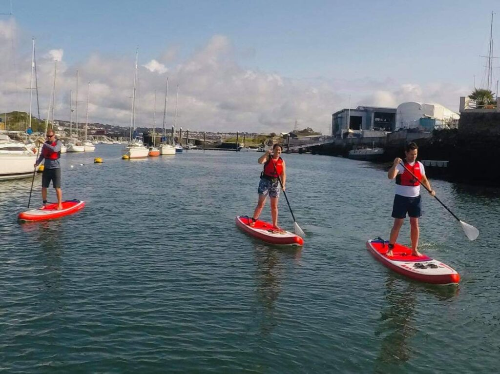 paddleboarders on the water in Plymouth